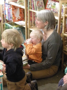 Abby Warner, with Peter and Isabel, listen, at Storytime, April 09.
