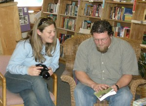 Teton Valley News photographer, Lauren Hall, talks with Sam Walton at his book signing.